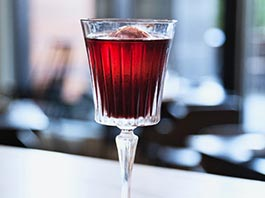 red cocktail in challis